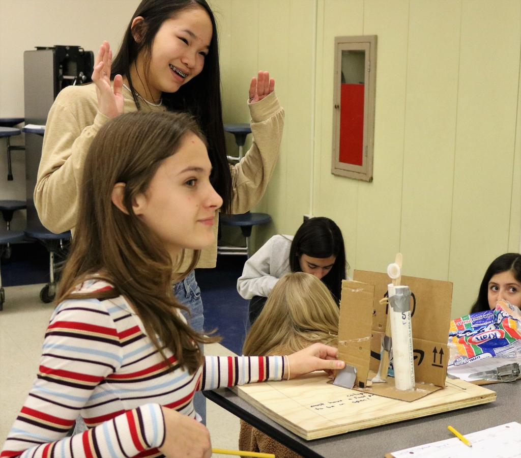 Photo of students testing handmade catapult during Science Olympiad at Roosevelt Intermediate School.