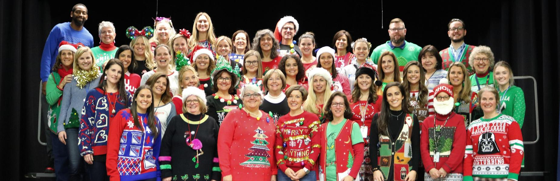 Photo of McKinley staff dressed in ugly sweaters.