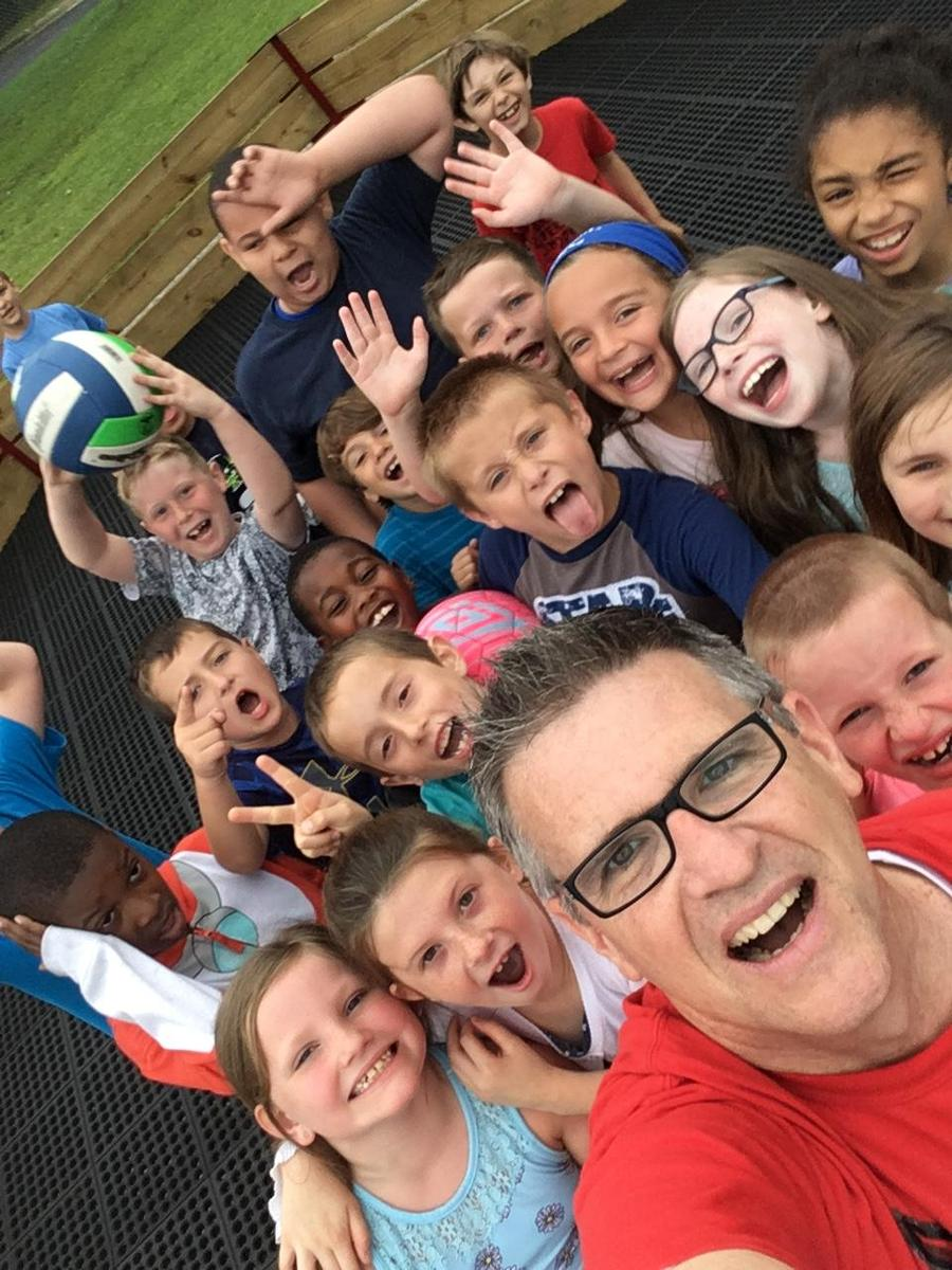 mr. brennan with students at recess