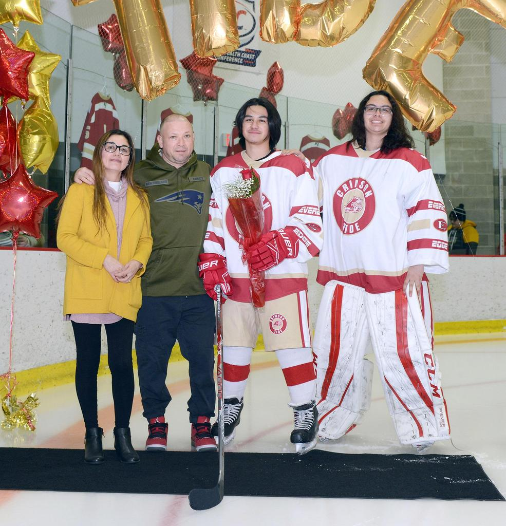A senior hockey player and relatives