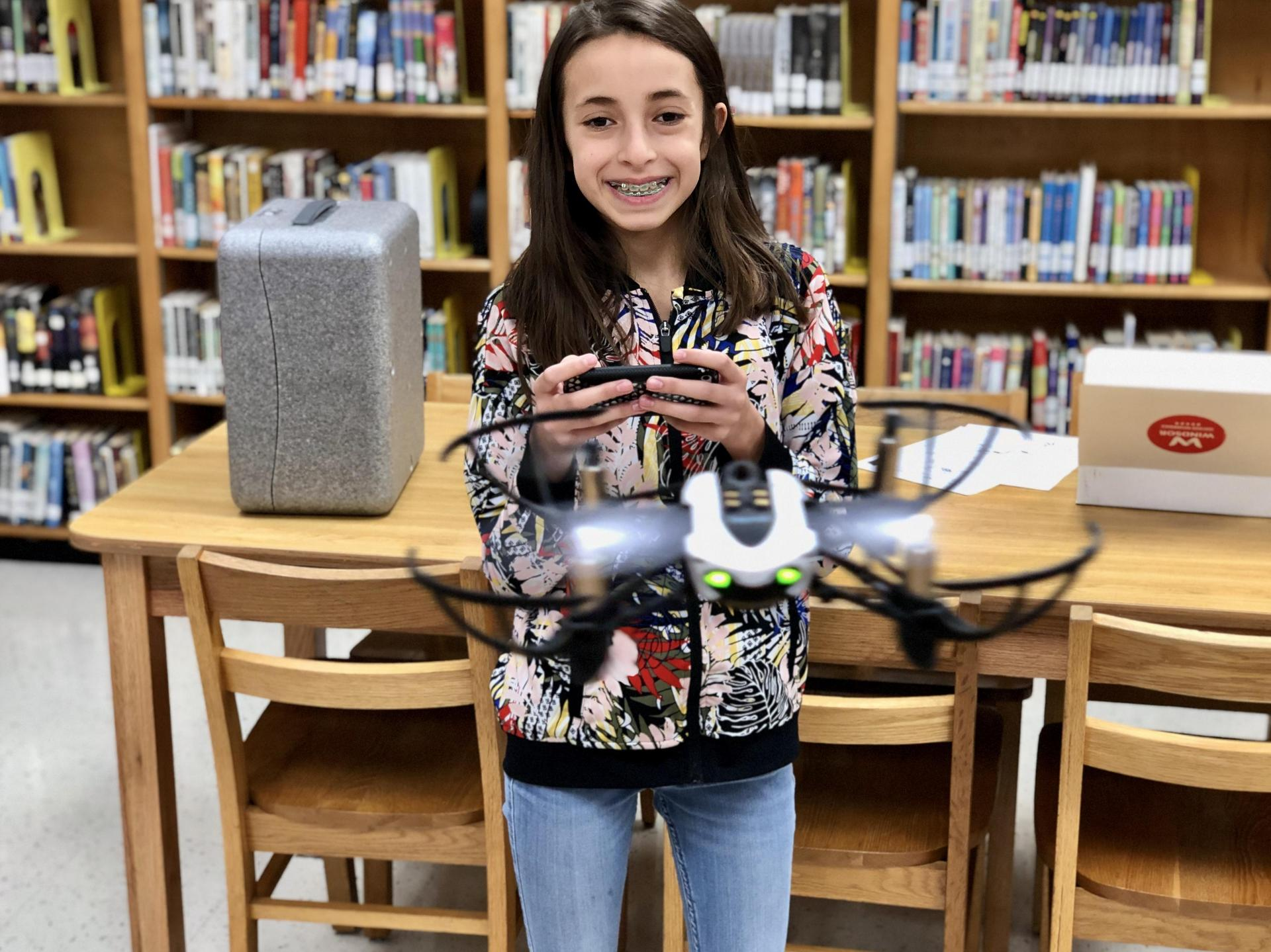 Student is driving a drone.