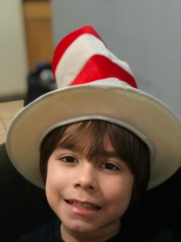 Boy wearing cat in the hat hat