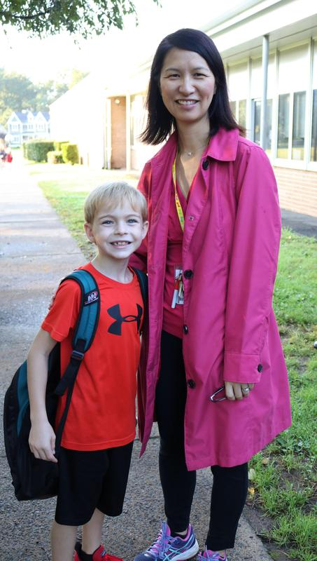 Jefferson principal Susie Hung escorts student on Walk to School Day.