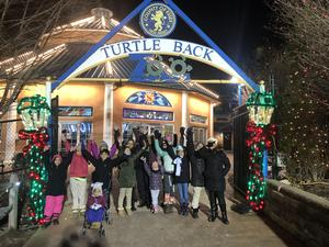 children in front of the turtle back zoo entrance