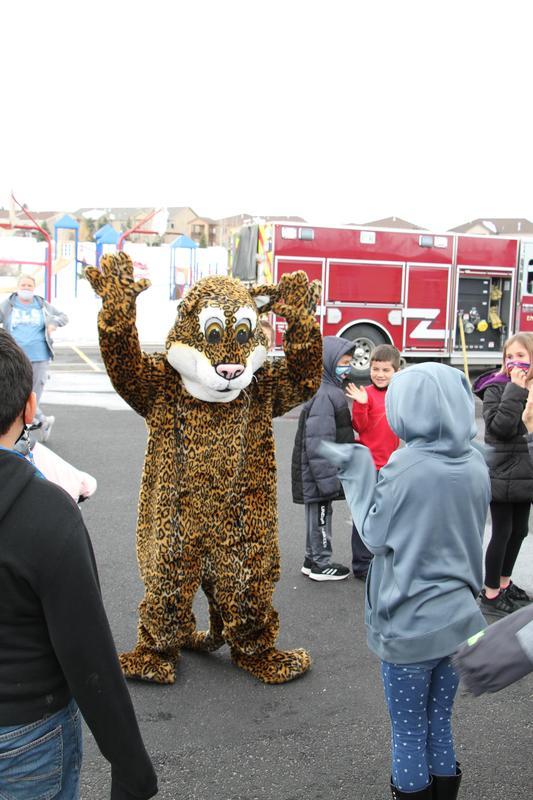 Manor Heights Jaguar mascot greeting students