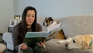 Picture of the principal getting to read a book