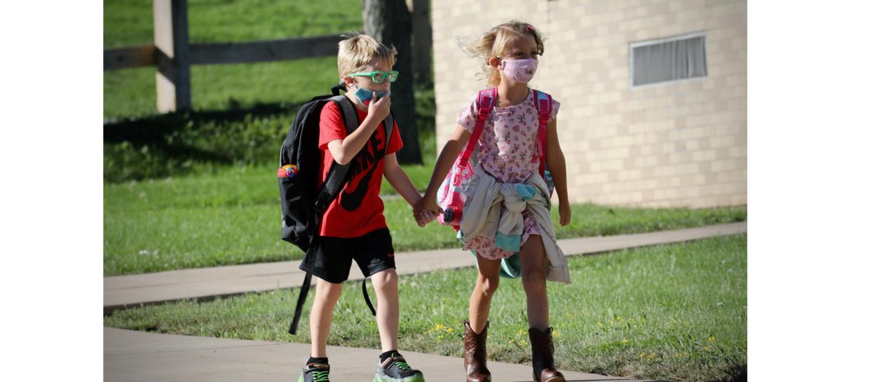 2 students walking to school