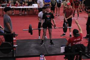 male student lifting in a power lifting competition