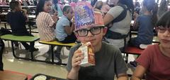 student eating in cafeteria