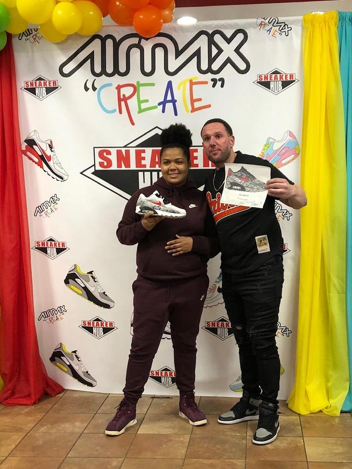 8th graders Jazmine winner proudly showing off her winning design with the sneaker hub owner