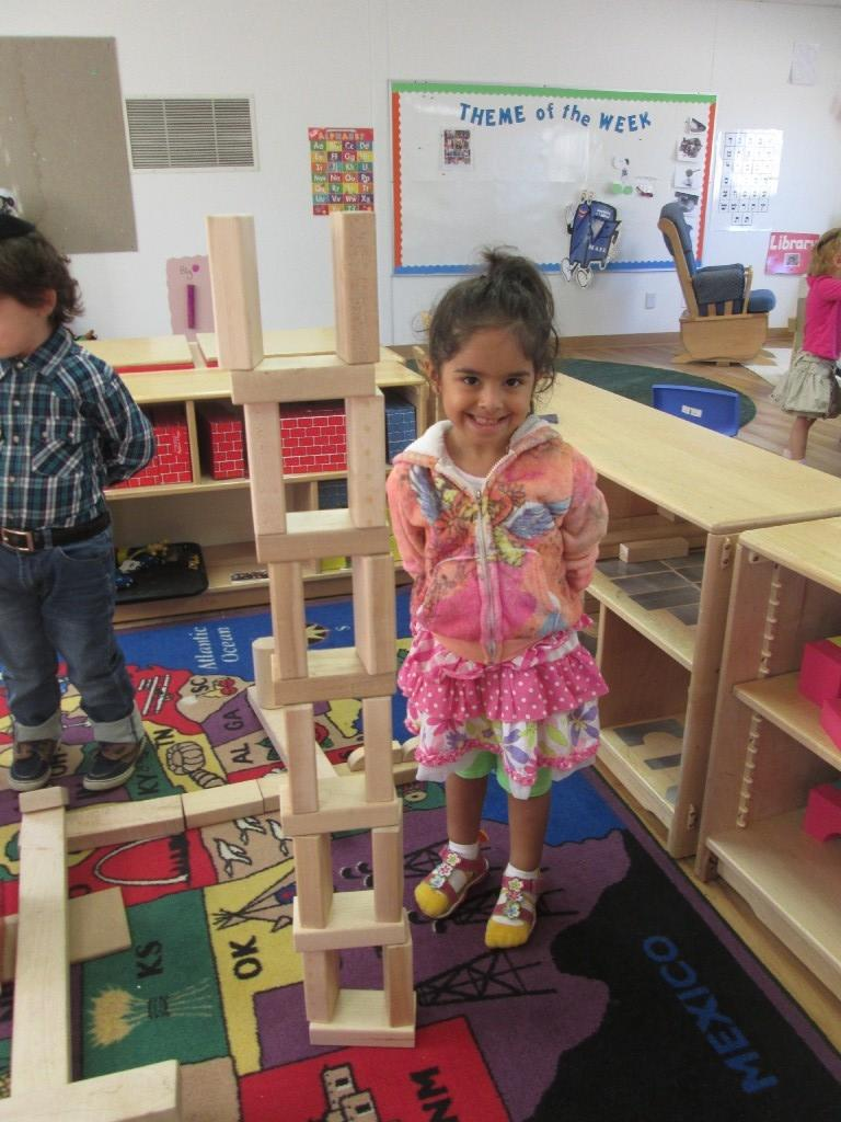Girl with a block tower
