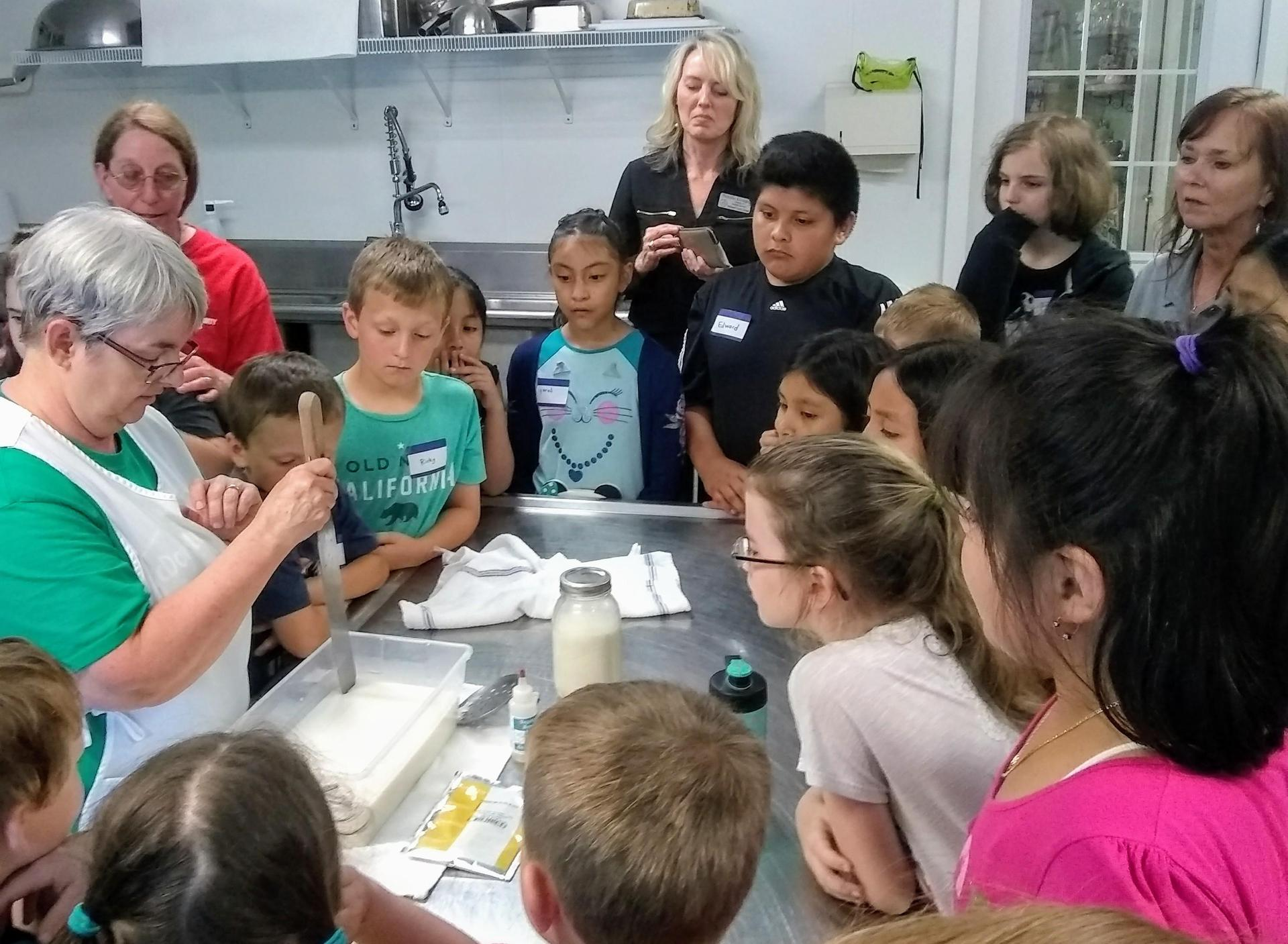 kids listen to the cheesemaker