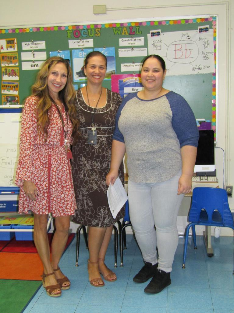 teachers and aides take photo with mother