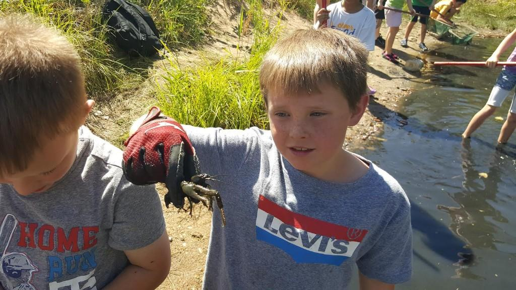 Third graders study aquatic habitats on their field trip to the Carson Nature Center.