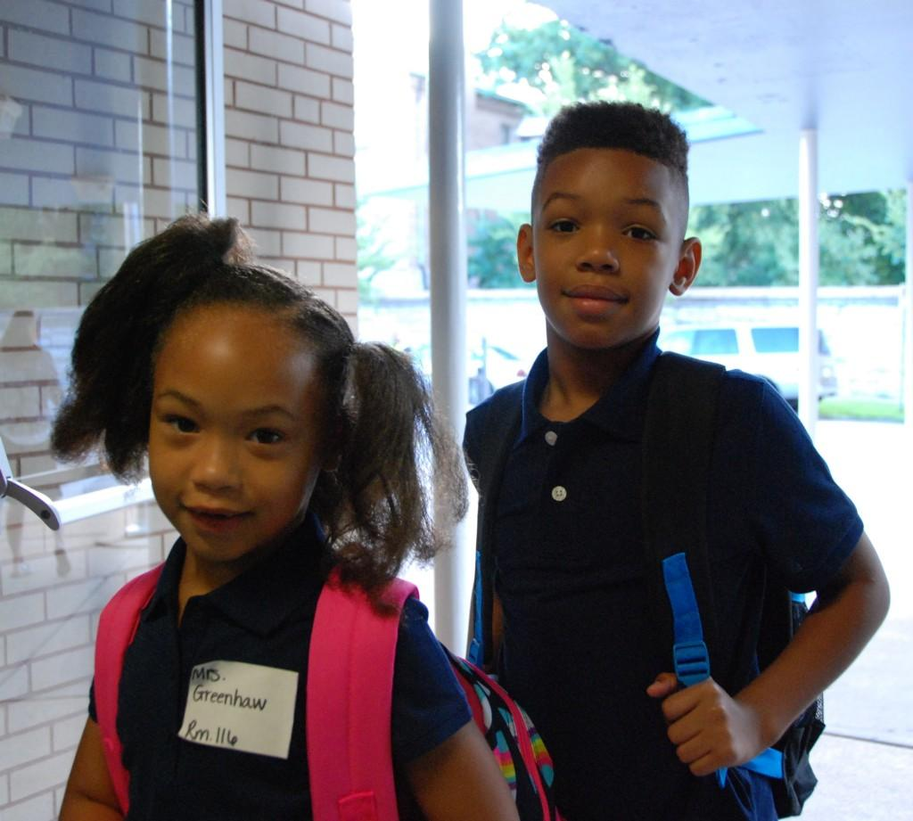 Students with backpacks, smiles, first day of school 2016-17