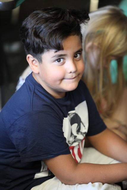 boy looking at camera with slight smile