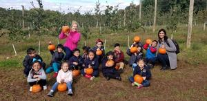 scarafiles class group photo each holding their pumpkins