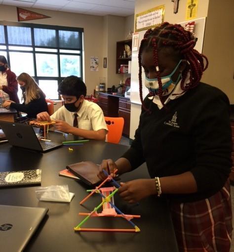 middle school students building a bridge