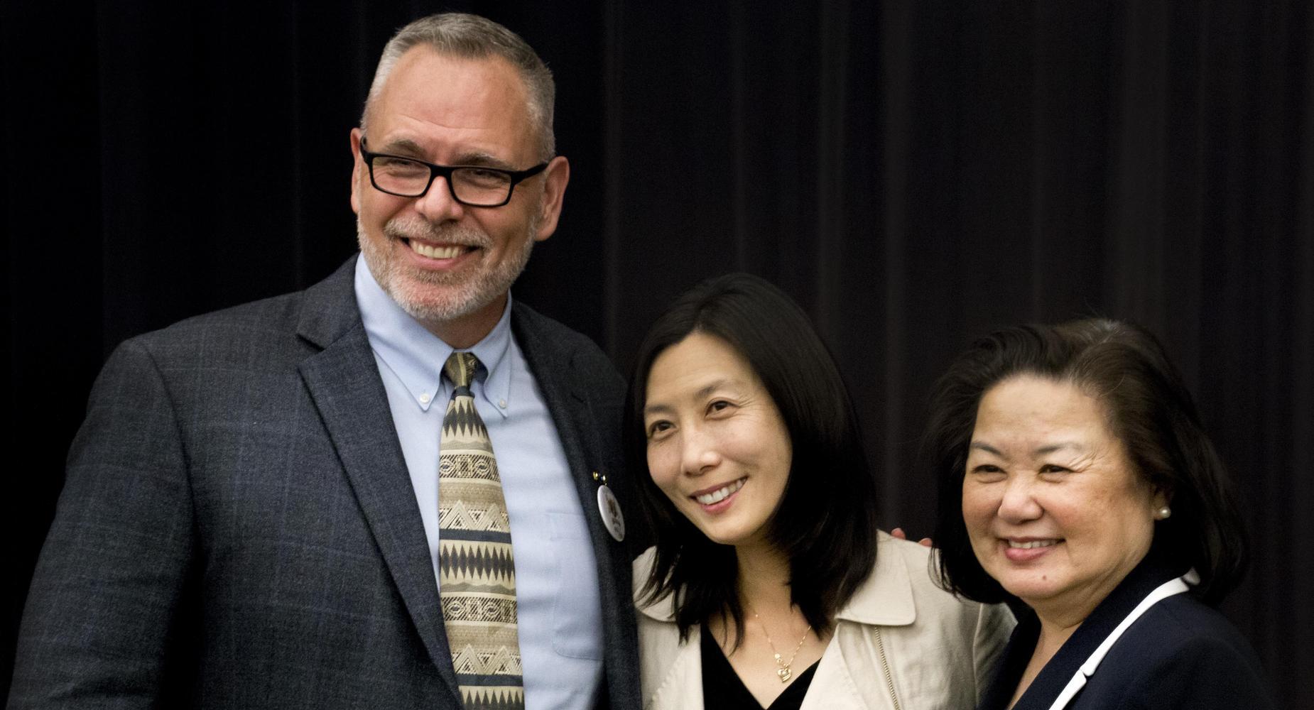 Dr. Sieu, guest speaker, and school principal