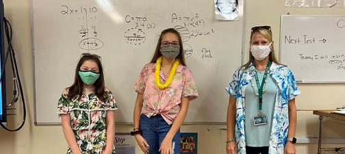 a picture of a teacher and two students