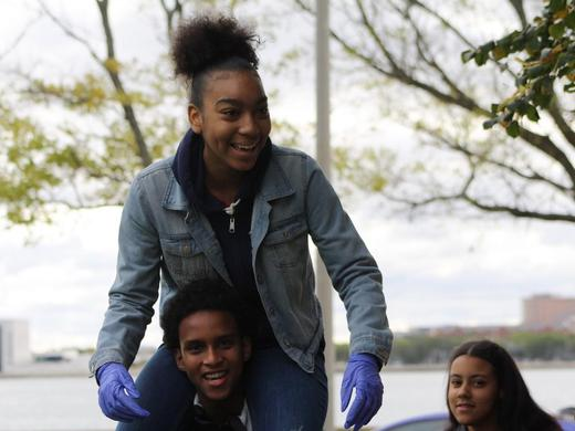 Two students have fun while participating in CoaH's annual Service Day.