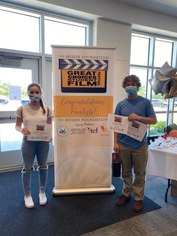NyKole Vartanian and Camren Zoet with their awards won at the Meijer Great Choices Film Festival.