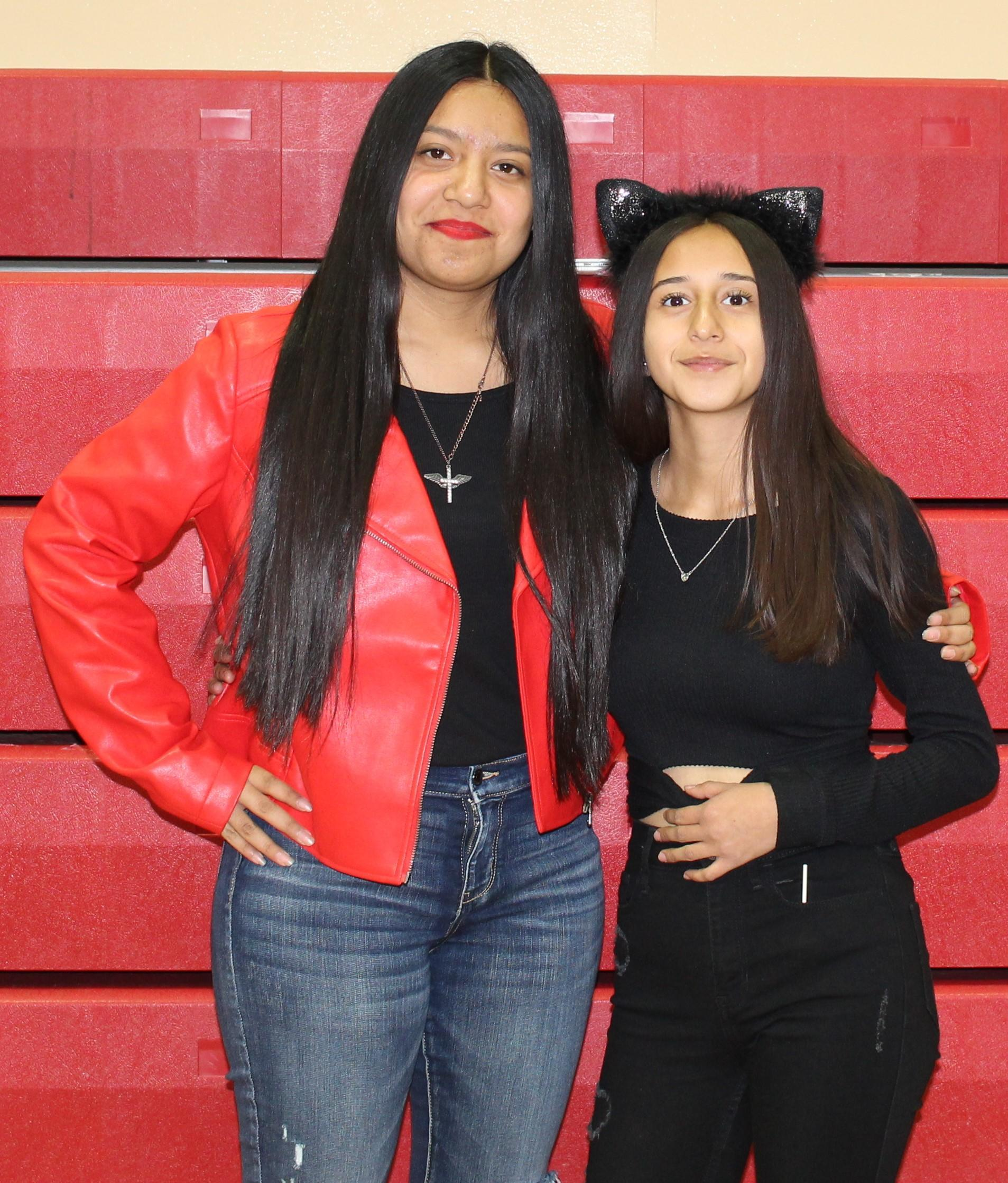 Isidora Flores as Micheal Jackson and monquie Hernandez as a Cat
