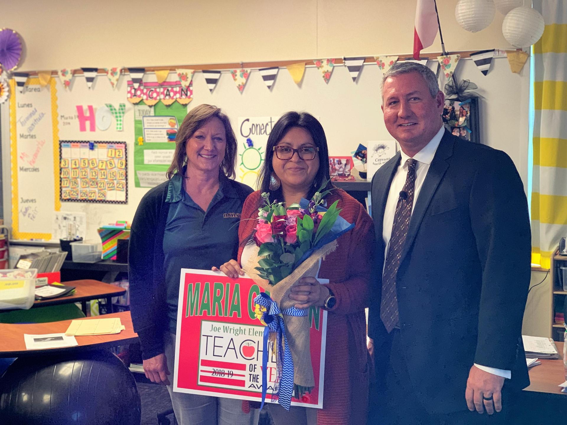 Maria Galvan with principal and superintendent