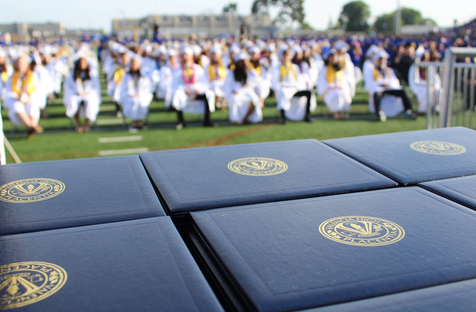 Valencia High School diplomas at graduation ceremony.