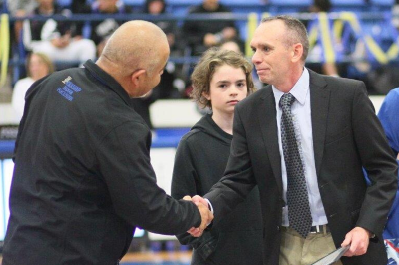 coach honored for military service
