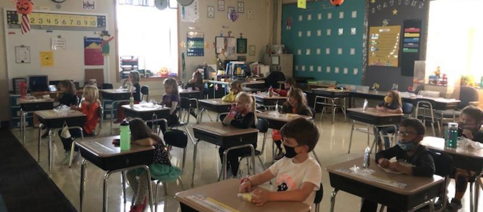 students sitting at desks watching movie