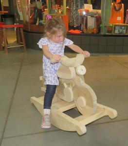 The woods students made rocking wooden toys and gave them out to young children.