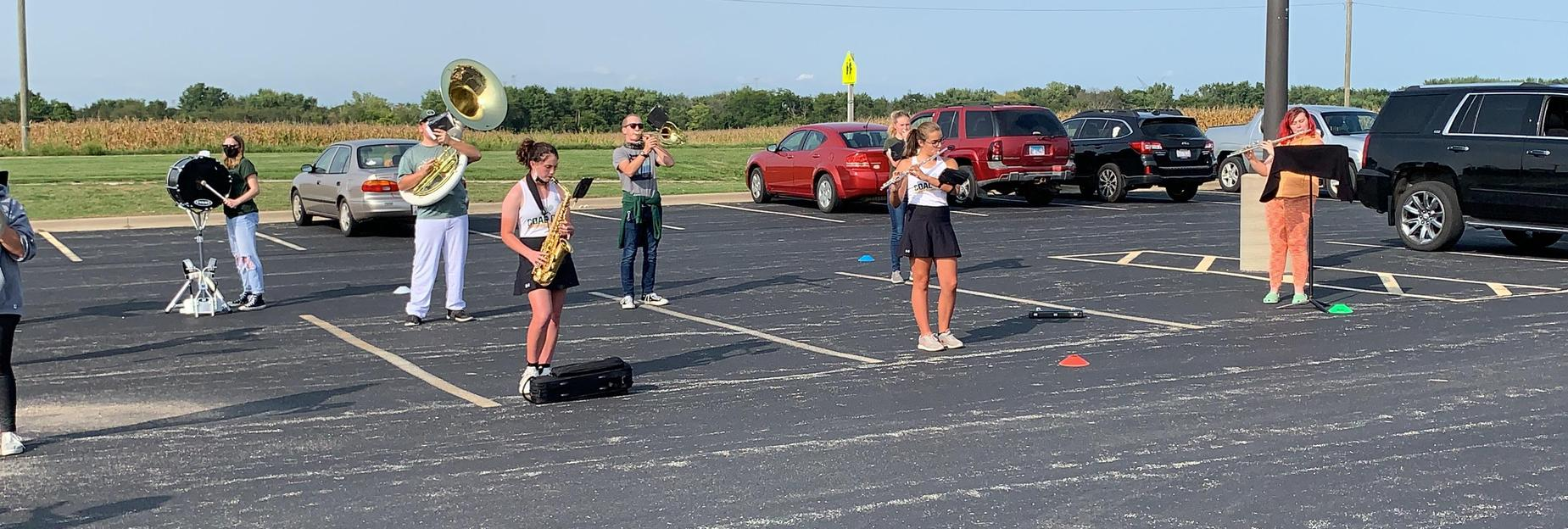 Marching band practicing in the parking lot