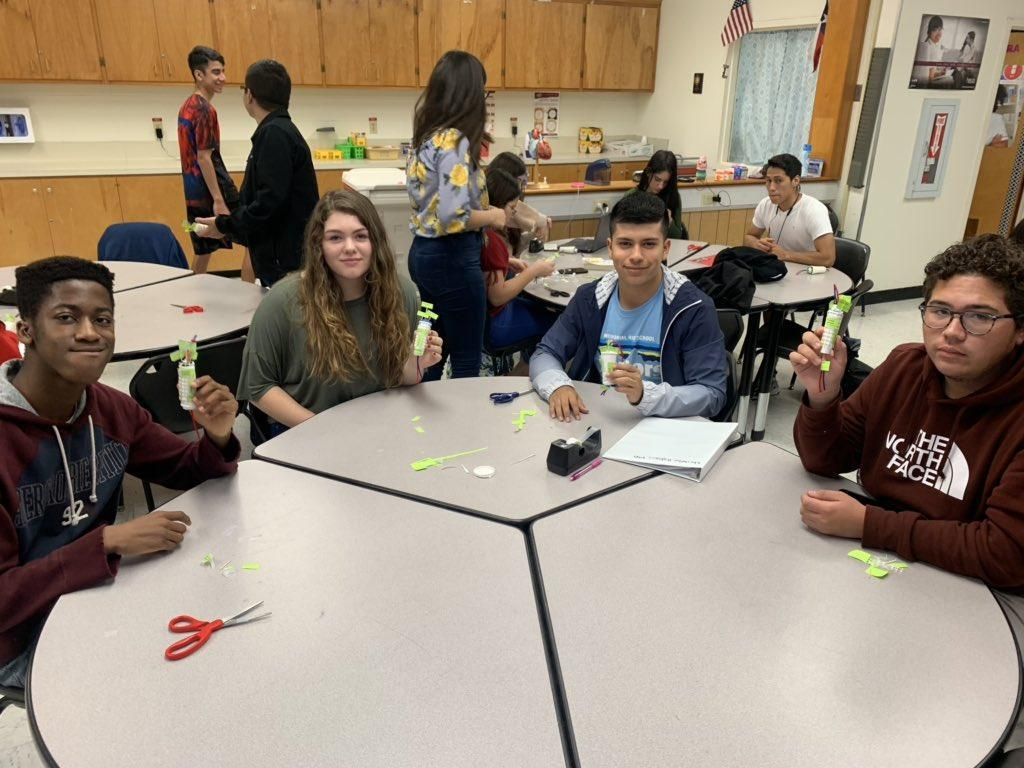 students around table creating arts and crafts
