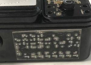 Side braille panel on meter