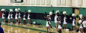 A picture of cheerleaders at a basketball game.
