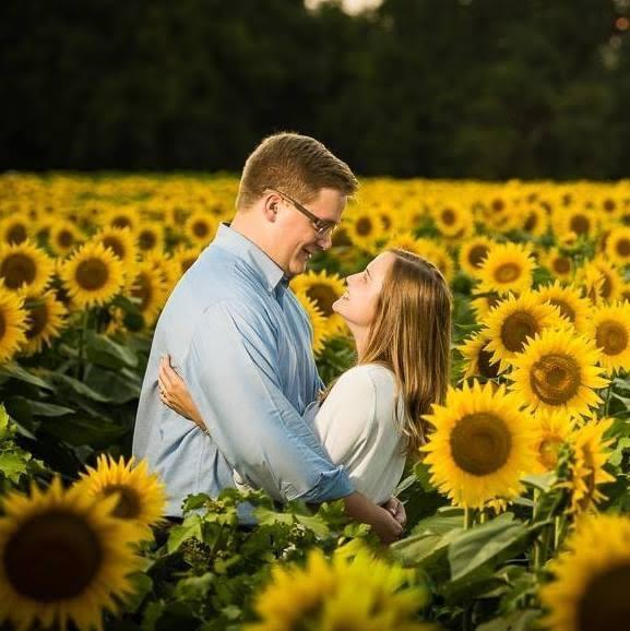 Husband (Alex) and I at Grinter Sunflower Farms!