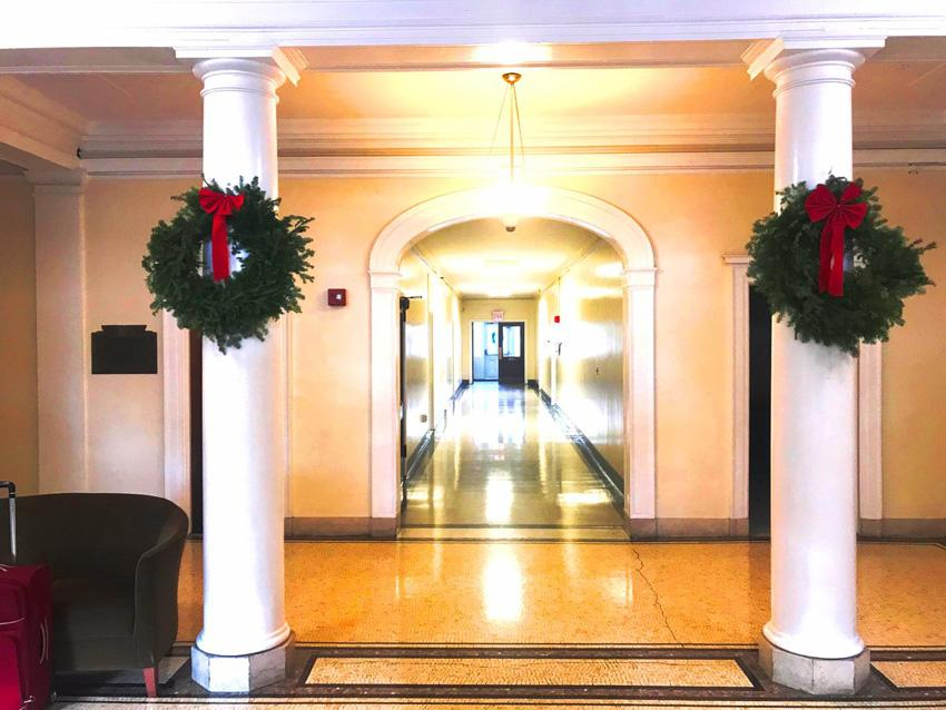 Insdie lobby of Schermerhorn hall with 2 wreaths on the columns