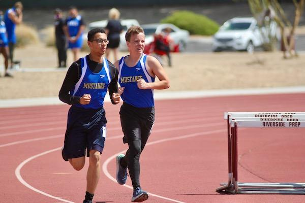 Track duo running at Meet #1