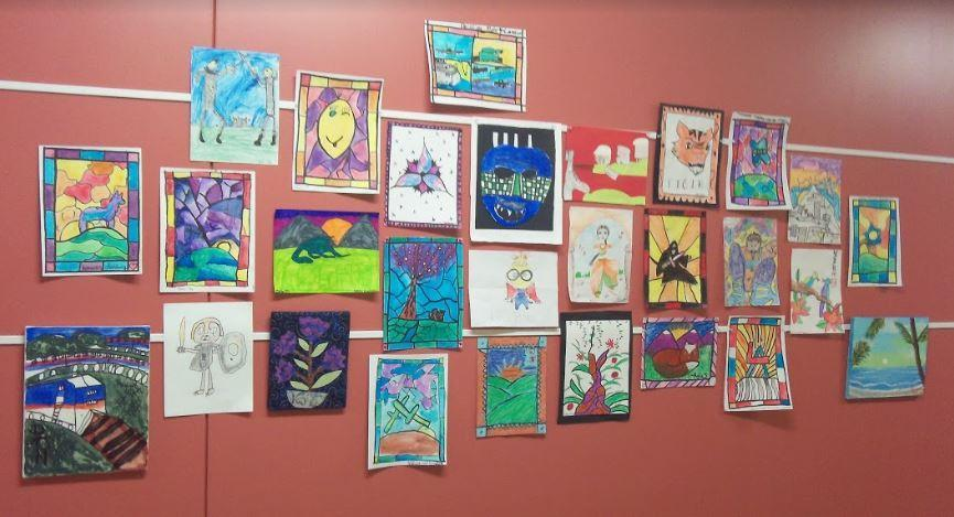 A panel of student artwork from a past all-school art show