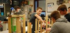 High School students building a project in their STEM robotics class.