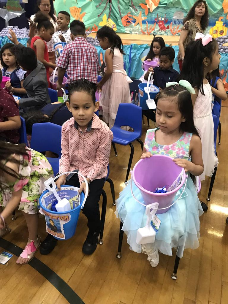 kids holding their summer buckets