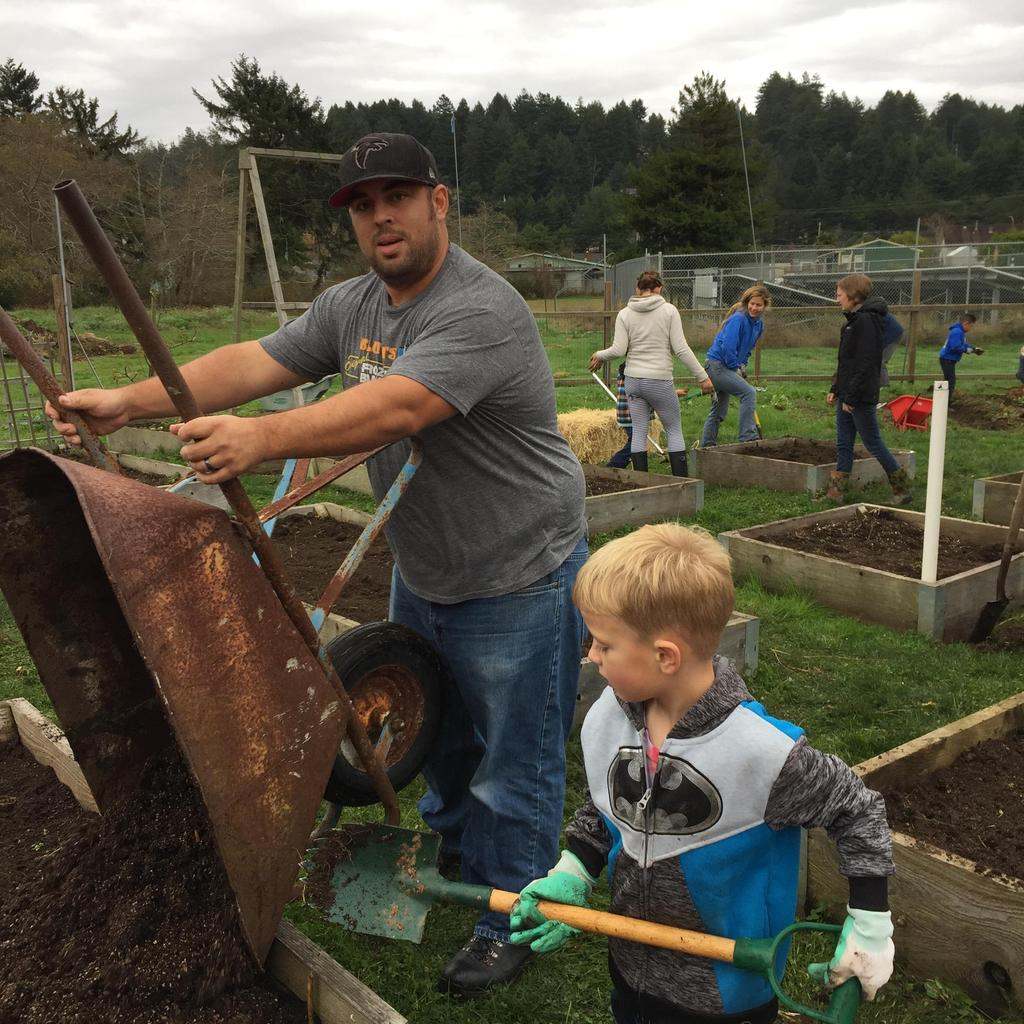 Student and parent at garden clean-up day