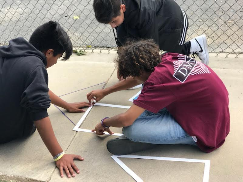 Mulcahy students volunteering to help with the stencil project.