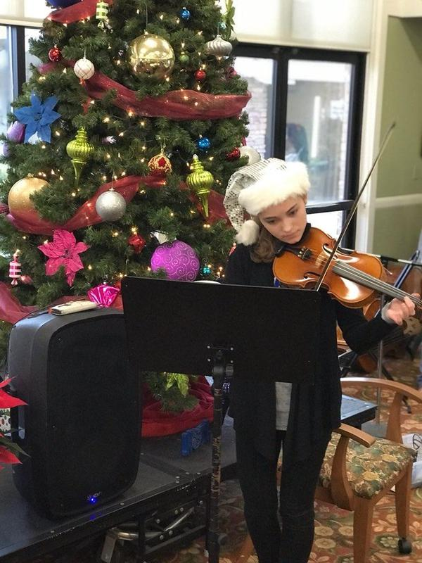 RMCHS student plays the violin at Sierra View Homes.