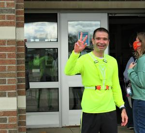 Page Principal  Mr. Bruno is all smiles after completing his run to school.