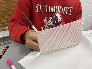 St. Timothy's students write cards.