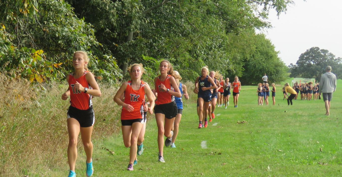 A group of TKHS cross country runners leads the pack.