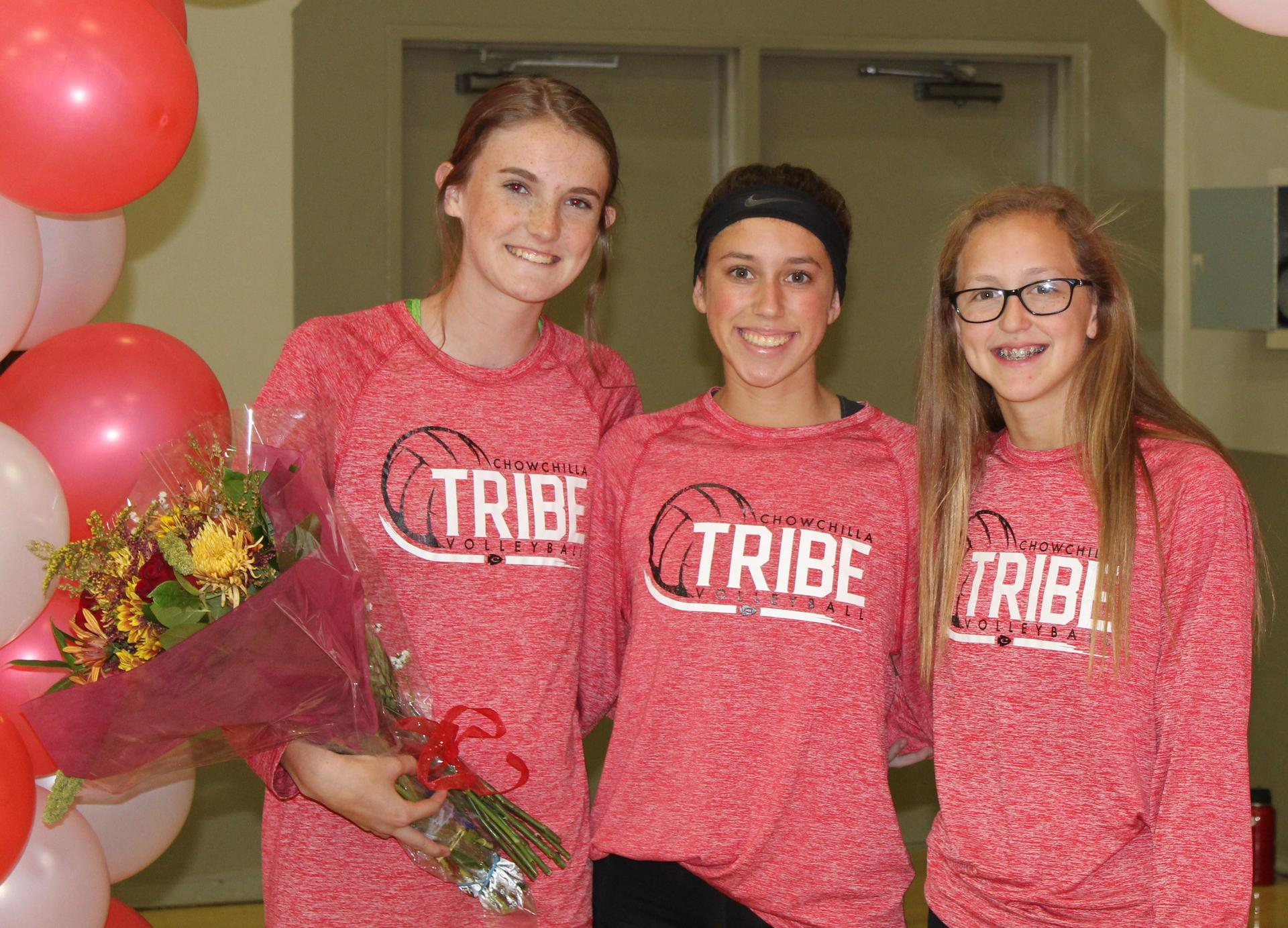 Sami Eastton and Lauren Bass escort Savannah Bass on Volleyball Senior Night.