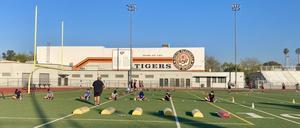 athletes practice on football field